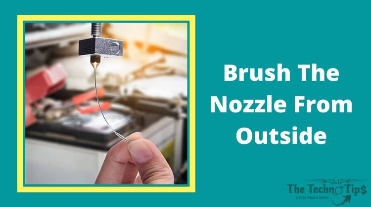 In this image a man hold Brush The Nozzle From Outside-Blocked 3D Printers Nozzle-thetechnotips